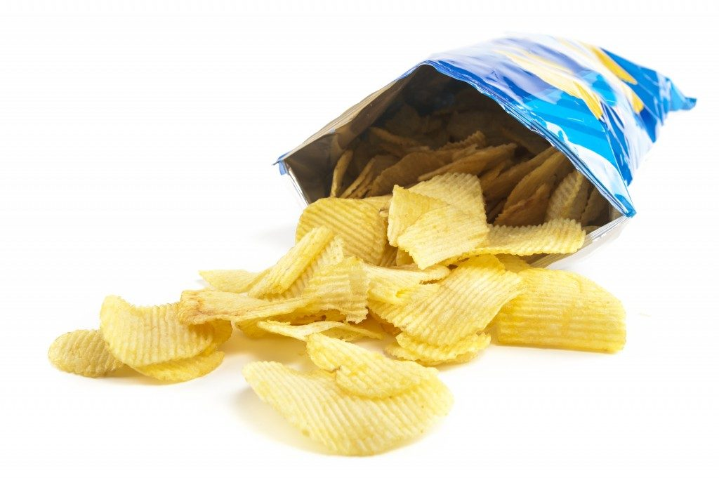 An opened bag of potato chips