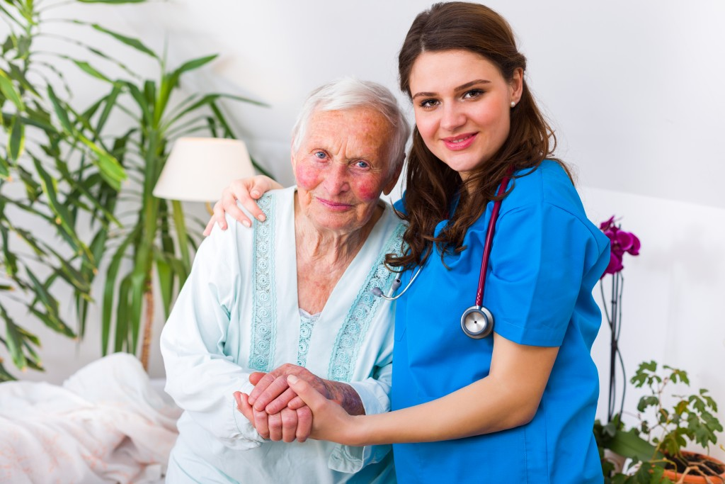 Old woman and nurse in a nursing home environment