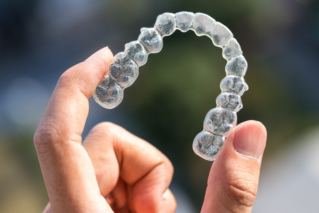Person holding an invisalign