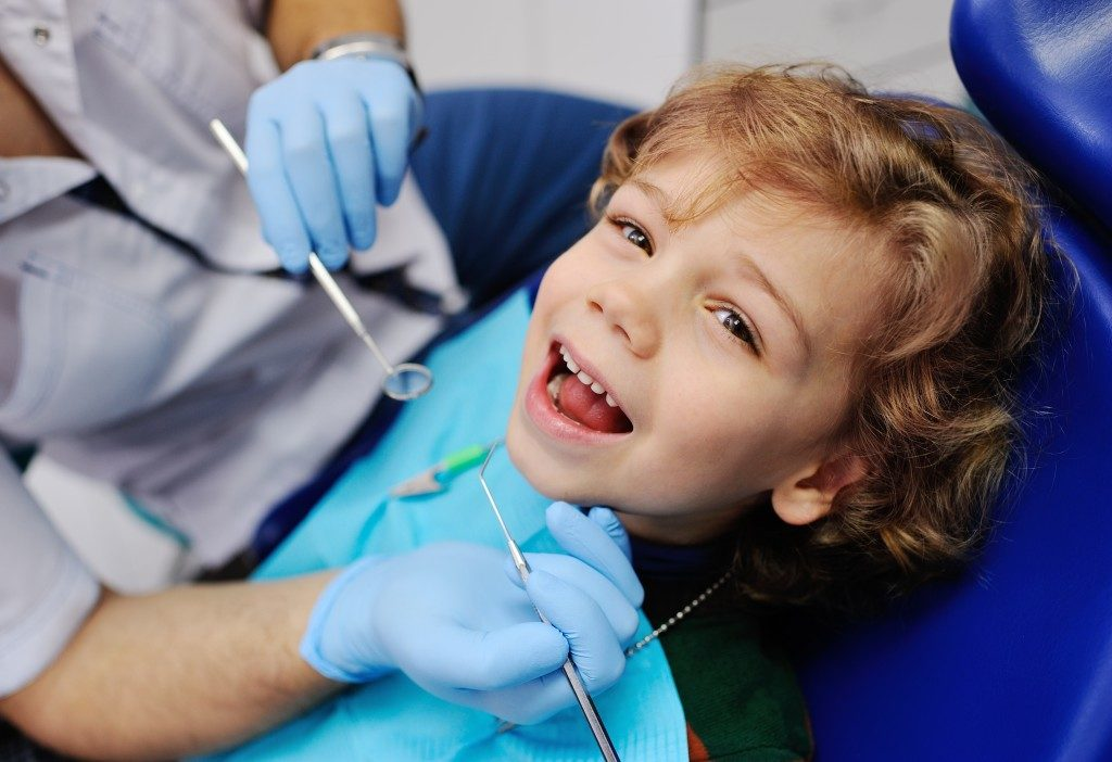 kid smiling after dental procedure