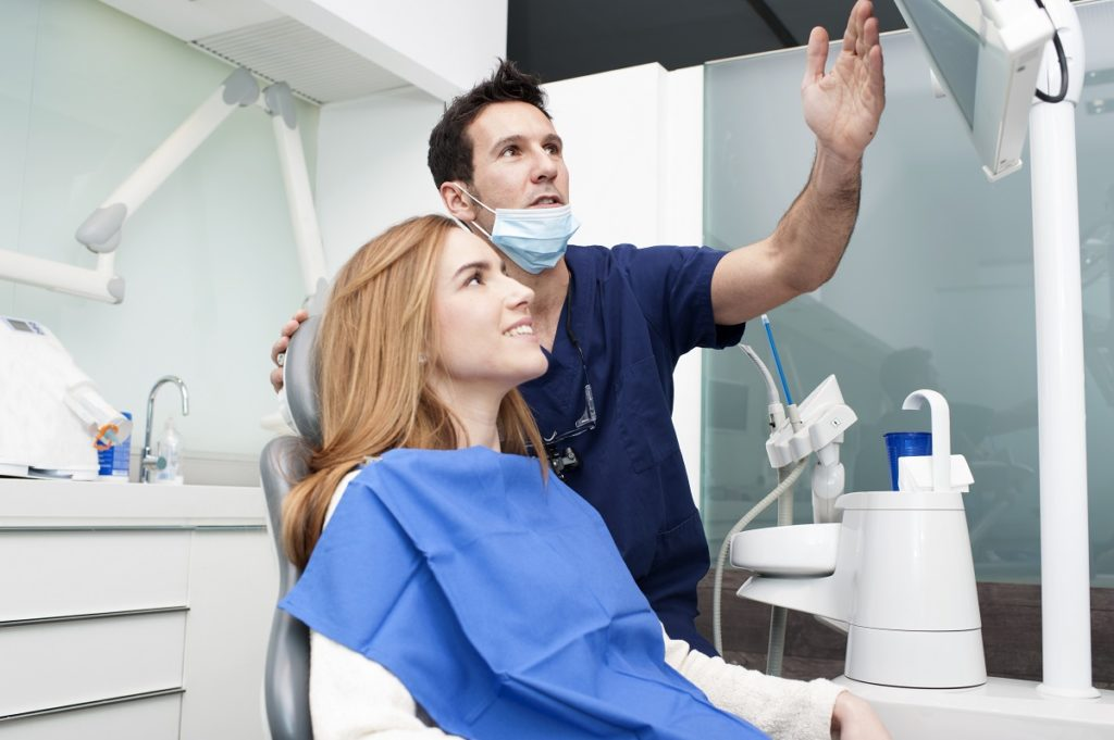 Dentist talking to her patient about procedures