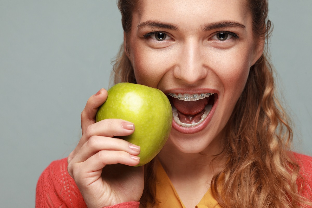 Woman biting an apple