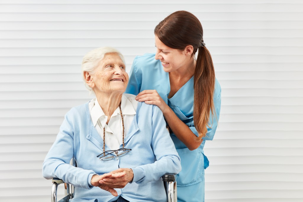 Elderly woman looking at a caregiver