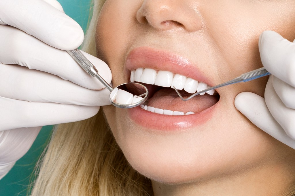 Woman with white teeth having a dental check up